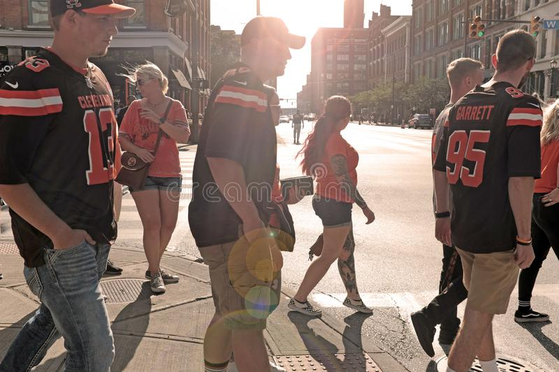 Cleveland Browns fans make their way through the Warehouse District in Cleveland, Ohio, USA. royalty free stock photo