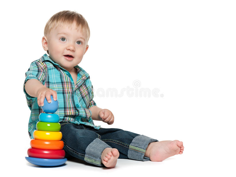 Clever baby boy with toys stock images