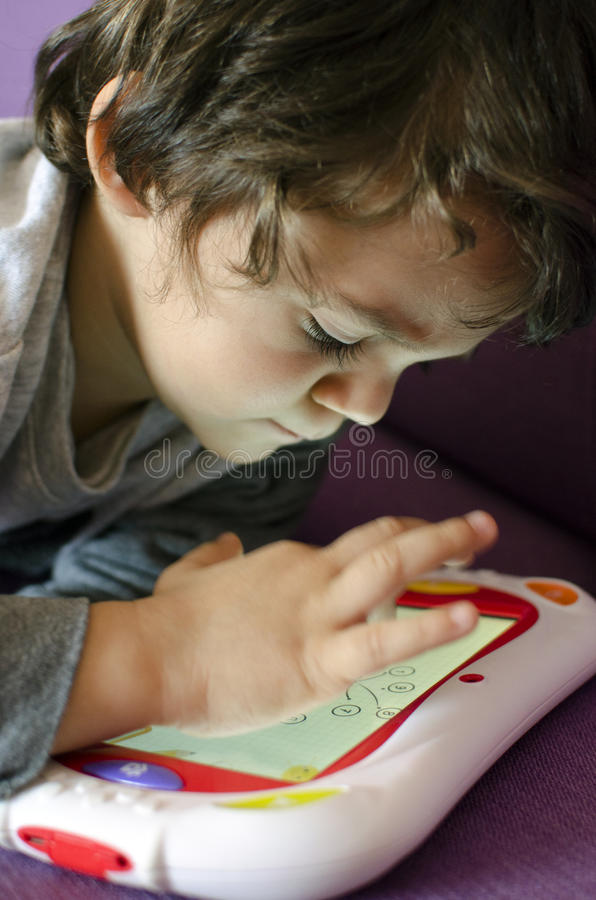 Clever child playing royalty free stock photo