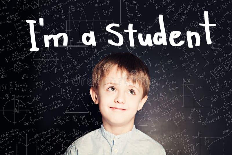 Clever child pupil on blackboard background portrait. stock photo
