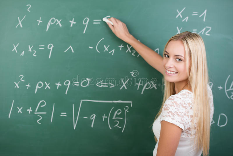 Clever confident female student in the classroom stock image