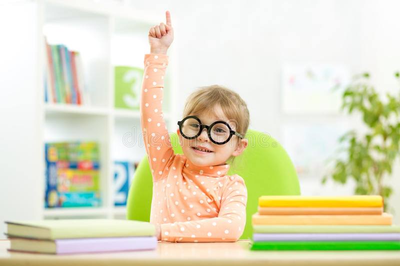Clever kid child girl with books indoors royalty free stock photo