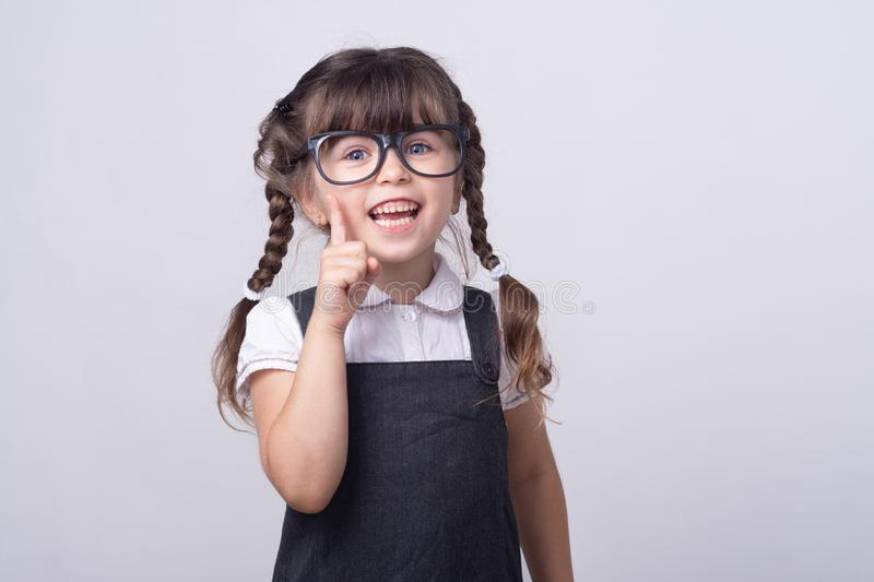 Clever kid in glasses and school uniform. Genius child. Kids and great idea. Tidy hairstyle. stock photo