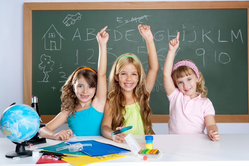 Clever kids student group at school classroom royalty free stock images