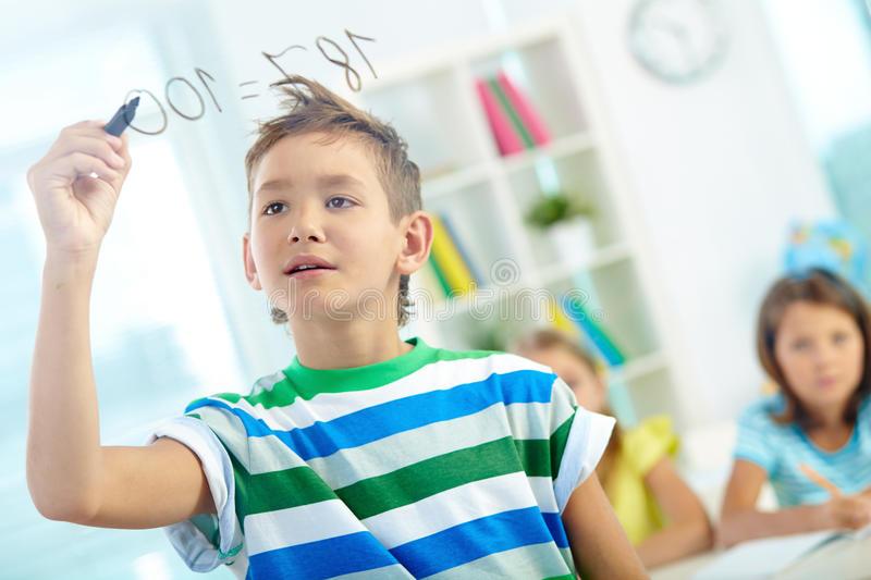 Clever schoolboy stock images