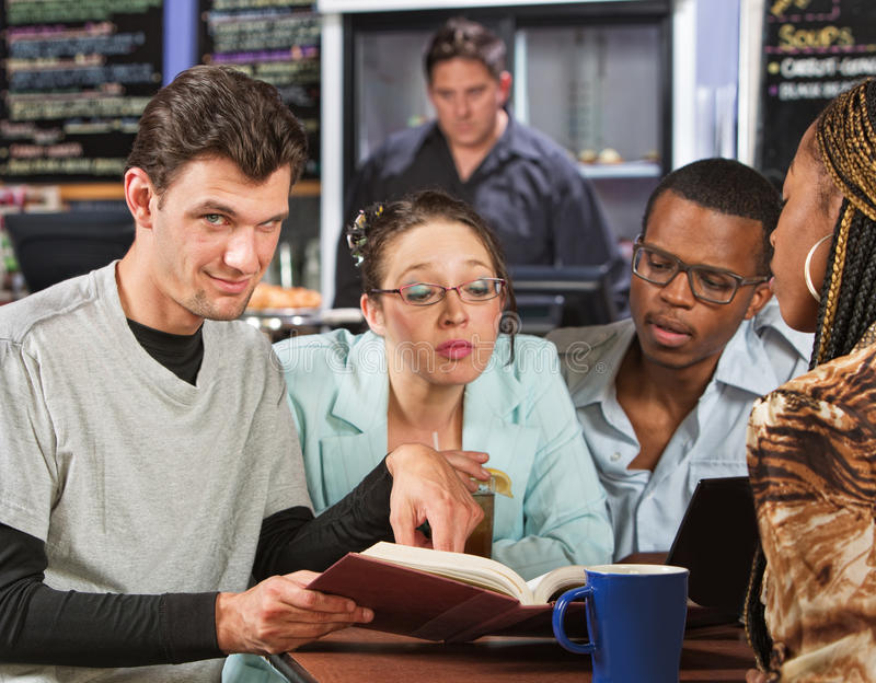 Clever Student with Friends. Clever male with students in coffee house stock photography