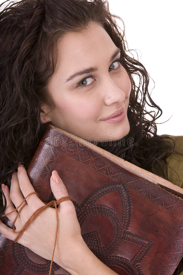 Clever woman with old book. royalty free stock photography