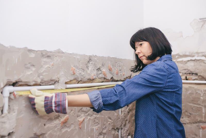 Woman using measuring tape stock photo