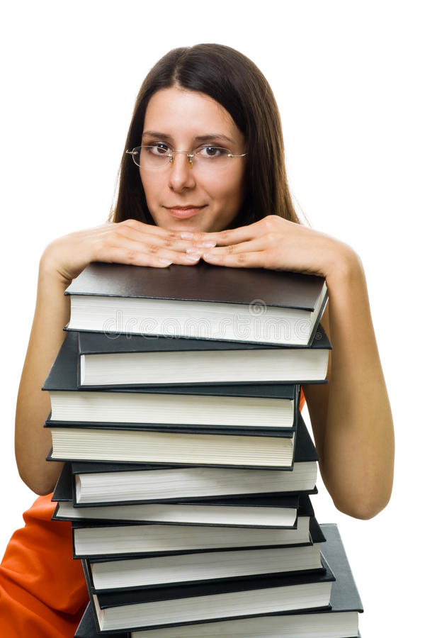 Clever woman student on pile of books stock images