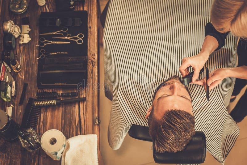 Cliënt in kapperswinkel stock fotografie