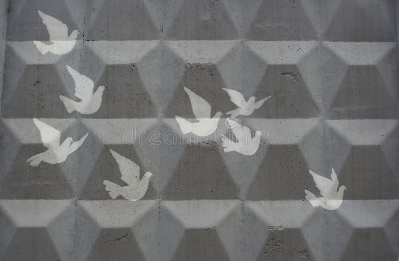Cliche drawing of doves. On a grey concrete wall stock photos