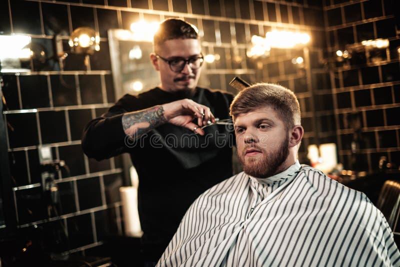 Client in barber shop. Handsome client in barber shop stock images