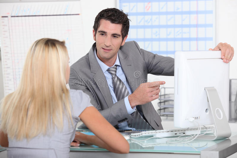 Client counselor. With a young blond woman royalty free stock photo