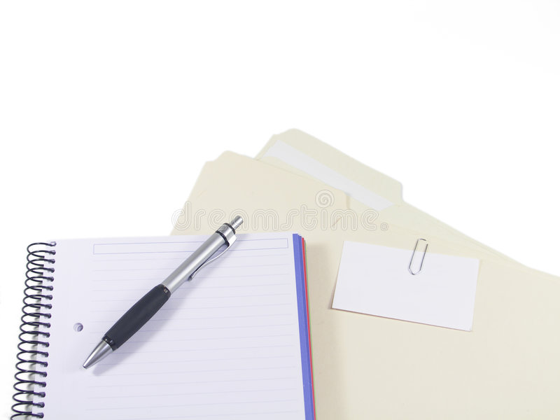Client files. A pen, blank notebook and folders with business card paperclipped to outside with pages showing stock photos