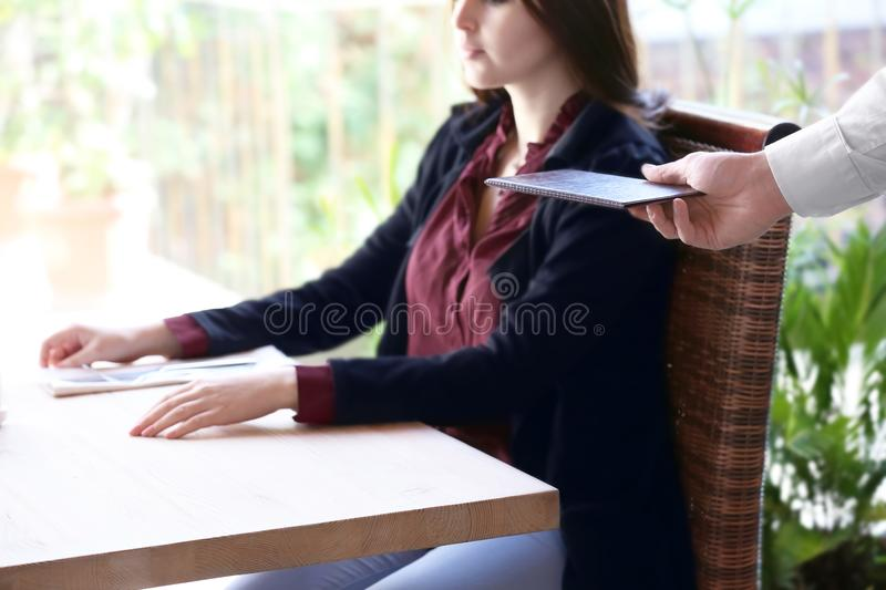 Client getting bill from waiter at restaurant, close up royalty free stock images