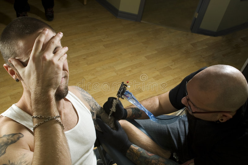 Download Client In Pain Getting A Tattoo Stock Photo - Image: 7853008