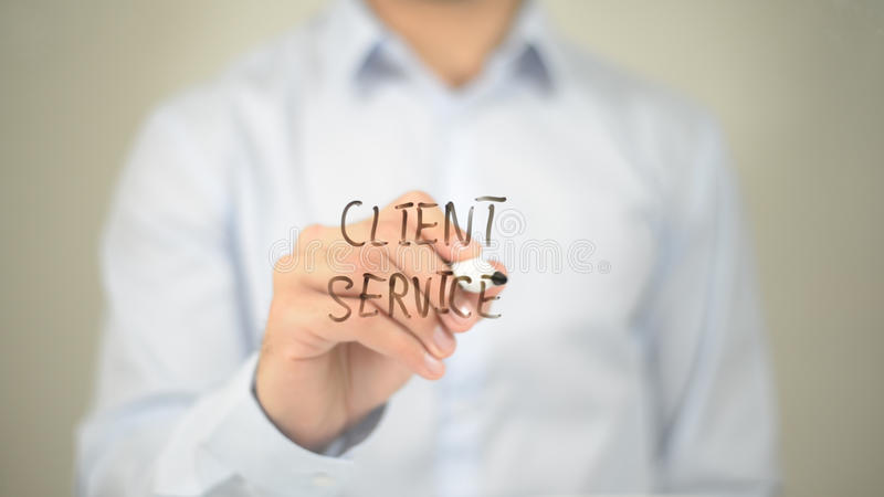Client Service, Man writing on transparent screen. High quality stock image