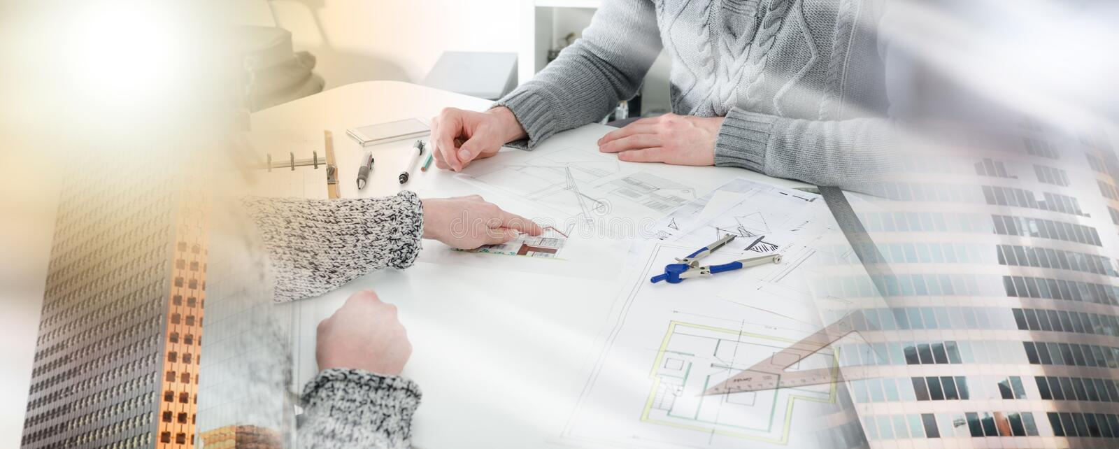 Client showing a detail on house plan; multiple exposure royalty free stock photography