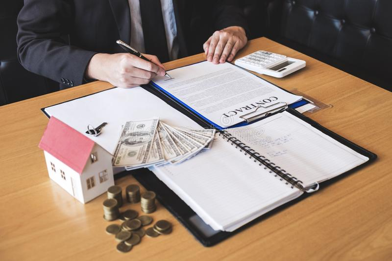 Client signing agreement contract real estate with approved application form, buying or concerning mortgage loan offer for and royalty free stock photo