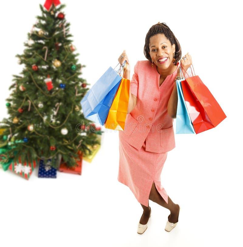 Cliente afro-americano entusiasmado do Natal fotos de stock royalty free