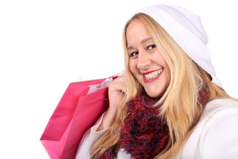 Cliente biondo della signora nell'usura di inverno fotografia stock