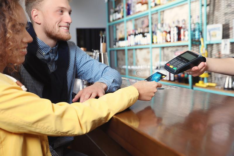 Clients using credit card machine for non cash payment. In cafe royalty free stock photos
