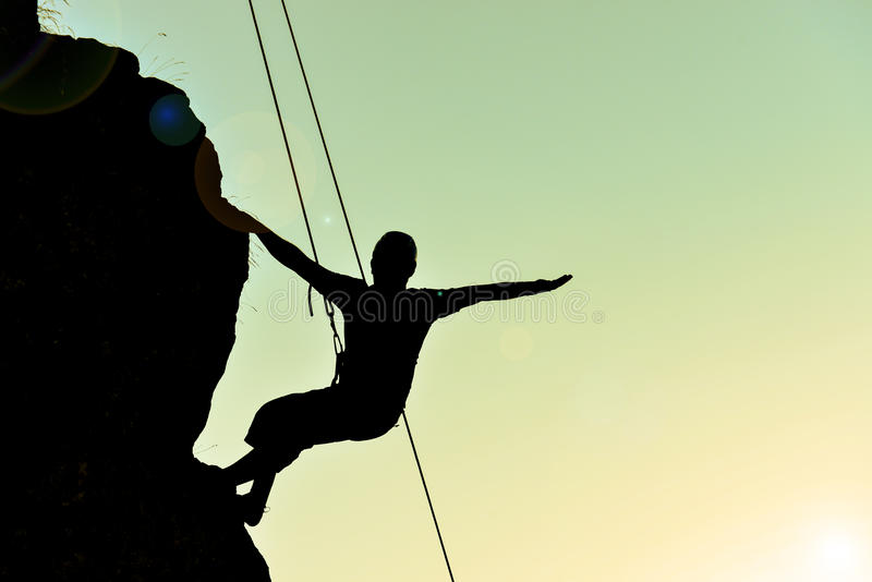 Cliff the climber silhouette stock photography