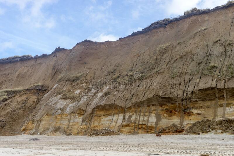 Cliff destroyed by the storm surge stock photo