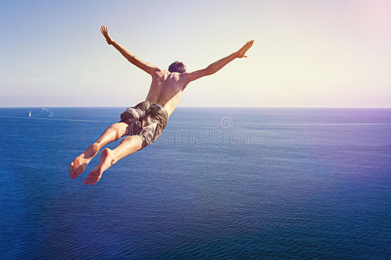 Cliff Diver. Jumping from a great high stock images