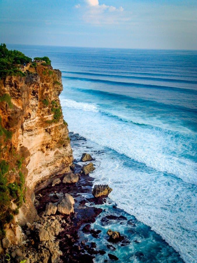 Cliff edge. Waves rolling in near the cliff edge. Taken in Ulu wata Bali stock photo