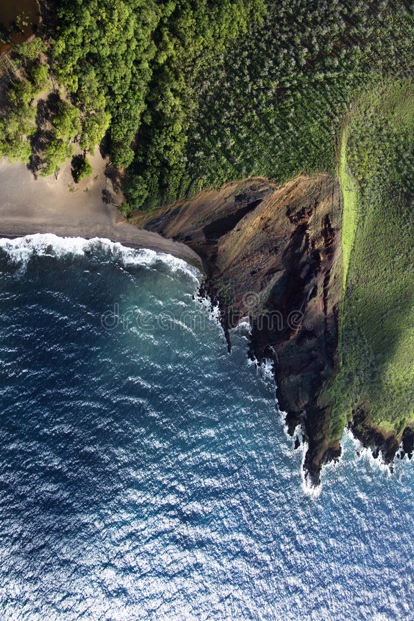 Cliff leading to beach. stock photography