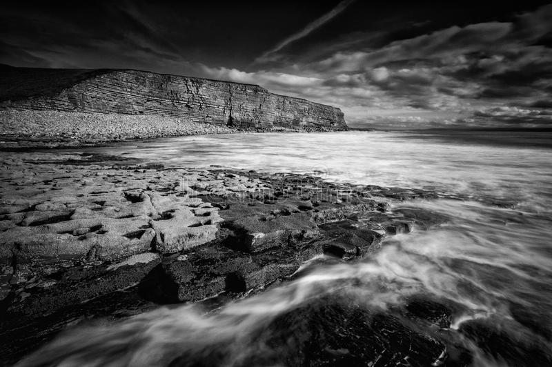 Cliff at Nash Point. Rocks in front of the cliffs at Nash Point, Wales royalty free stock photo