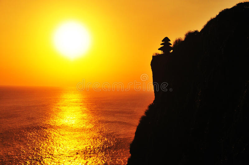 Cliff near the ocean under sunset stock photography