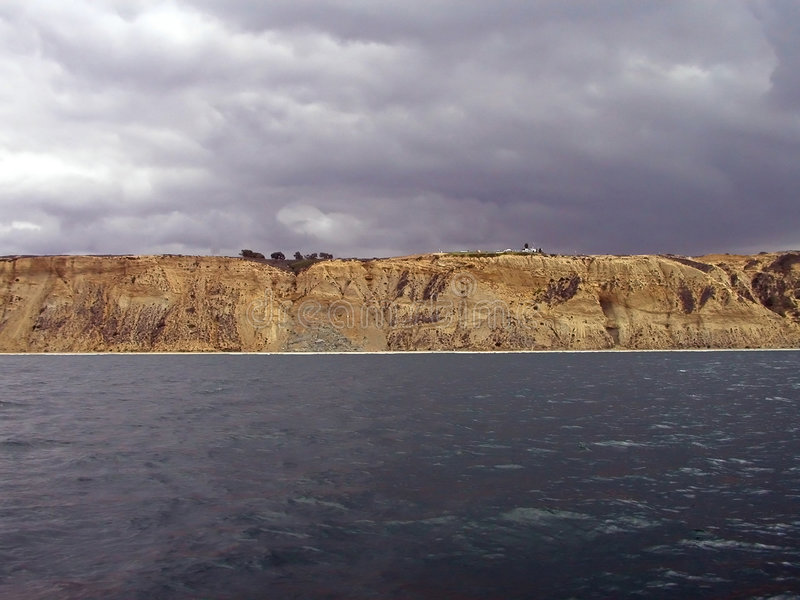 cliff oceanu piaskowe niebo zdjęcie royalty free