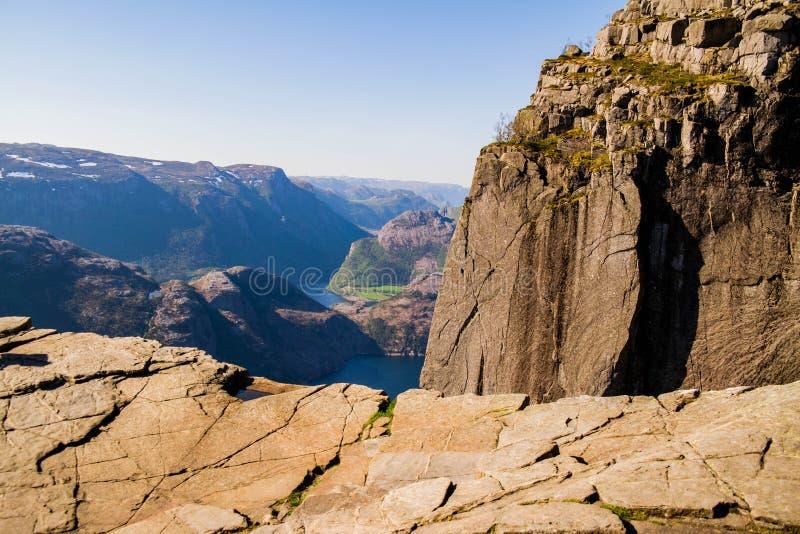 Cliff Preikestolen in Norway. Orange, cracked rocks. Beautiful landscape from a rock shelf royalty free stock photo