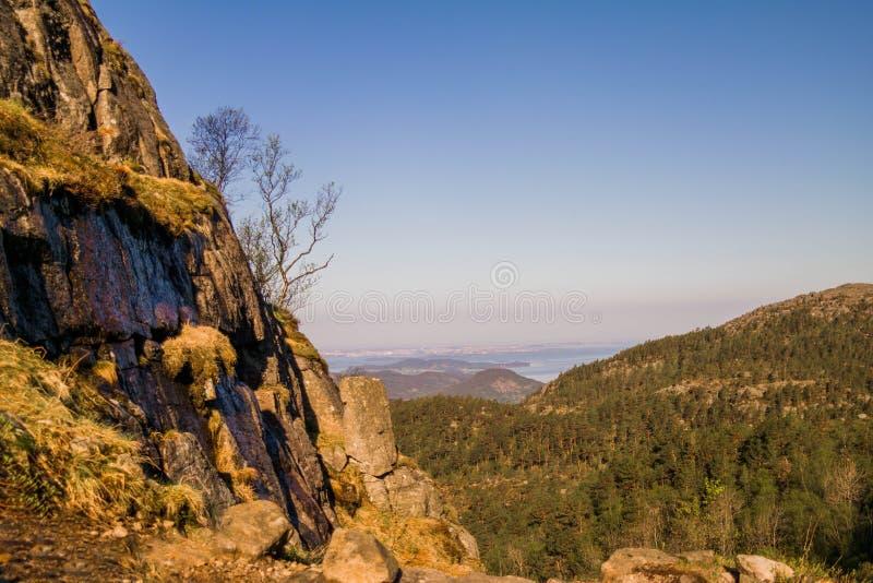 Cliff Preikestolen in Norway. Orange, cracked rocks. Beautiful landscape from the top stock photo