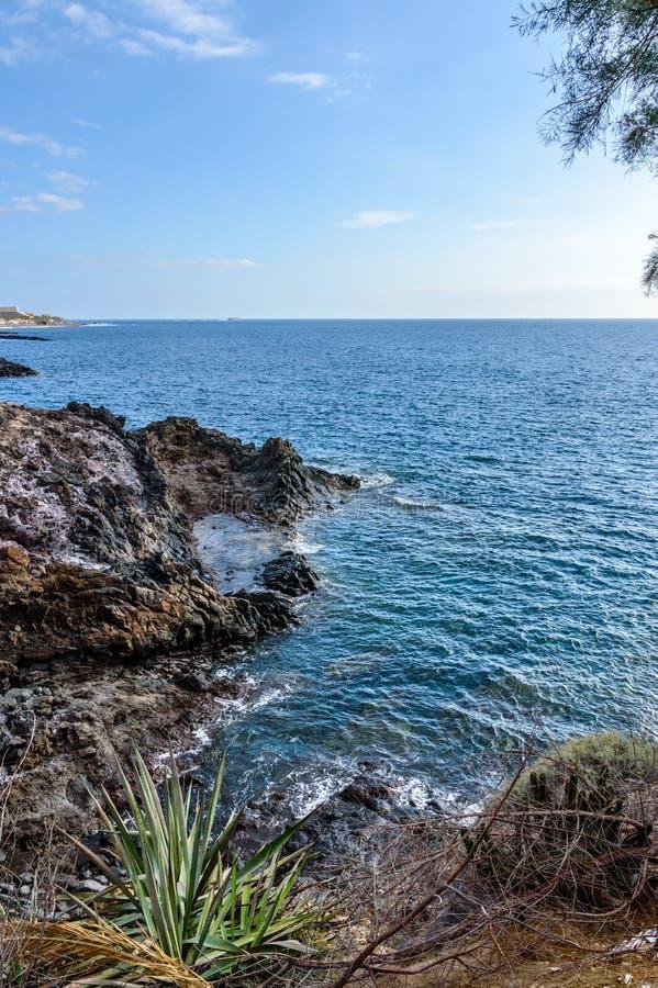 Cliff With A Privileged View Of The Infinite Ocean At Sunset Playa De Las Americas. April 11, 2019. Santa Cruz De Tenerife Spain stock image