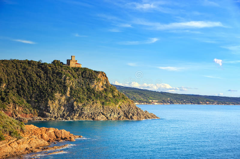 Cliff rock and building on the sea on sunset. Quercianella, Tuscany riviera, Italy. Europe stock photography