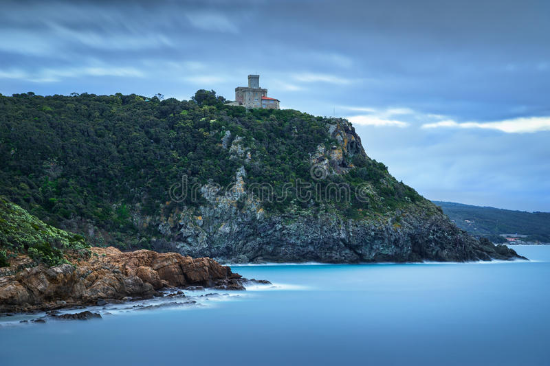 Cliff rock and building on the sea on winter. Quercianella, Tuscany riviera, Italy. Europe. Long Exposure royalty free stock photography