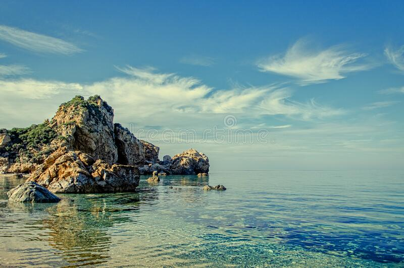 Cliff And Rock Formations On Calm Body Of Water During Daytime Free Public Domain Cc0 Image
