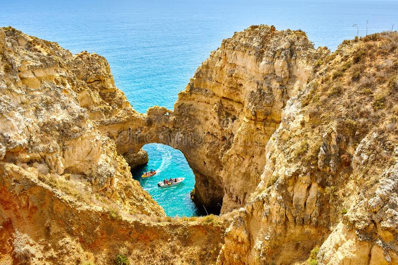 Cliff rocks and sea bay with turquoise water in Lagos, Algarve region, Portugal stock photos