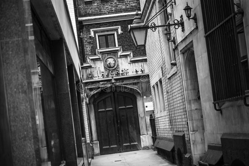 Clifford's Inn. LONDON, UK – MAY 17, 2014: Photo of a passage to Clifford's Inn off Fleet Street in London. The inn was founded in 1344. The photo is royalty free stock photo