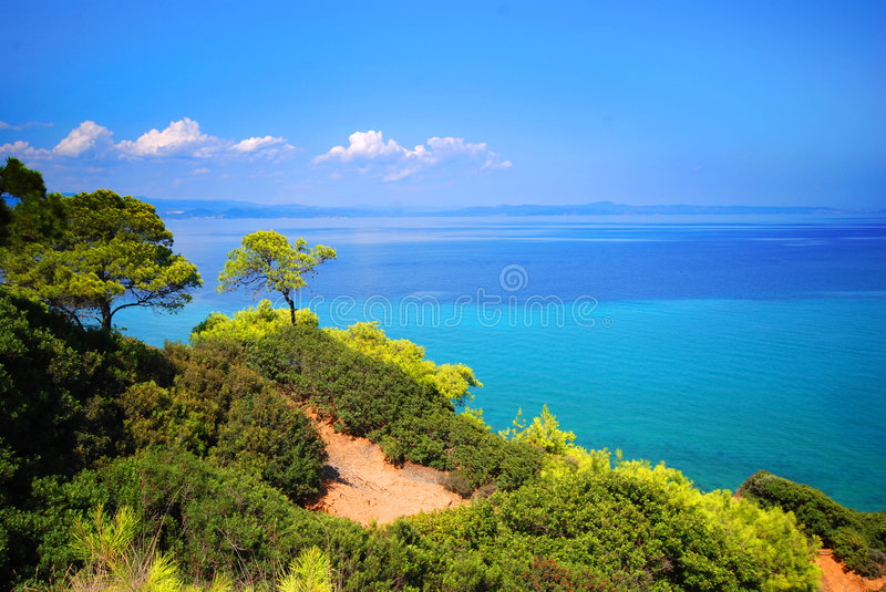 Cliffs along Aegean Sea. A view of the cliffs along the shore beside the Aegean Sea near Afithos, Greece stock photo