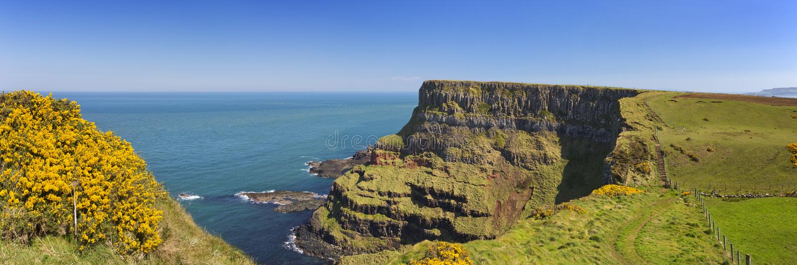 Cliffs along the Causeway Coastal Way in Northern Ireland. Cliffs along the Causeway Coastal Way on the coast of Northern Ireland on a bright and sunny day stock photography