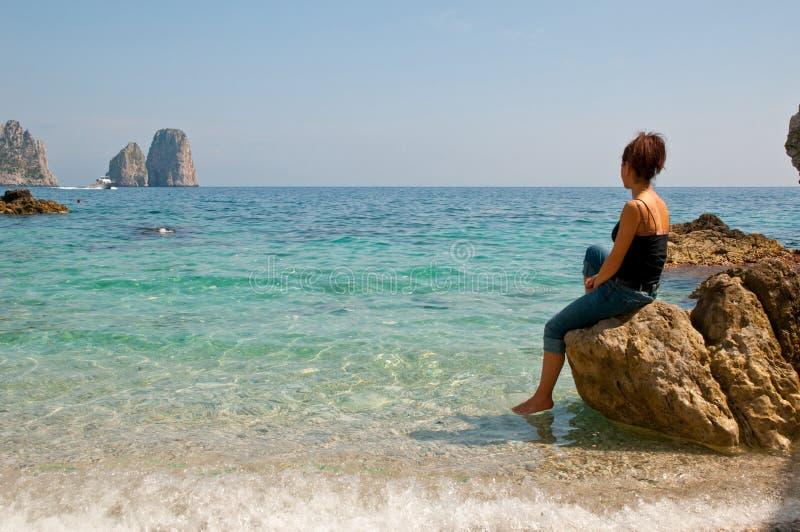 The cliffs of the Amalfi Coast Capri. Woman looking at the stacks Amalfi Coast royalty free stock images