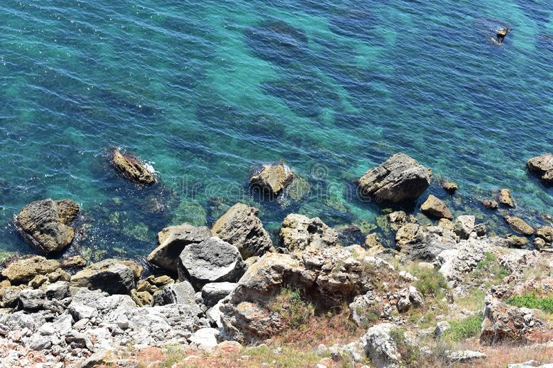 Cliffs at Black Sea with blue sky and calm water. In summer time royalty free stock images