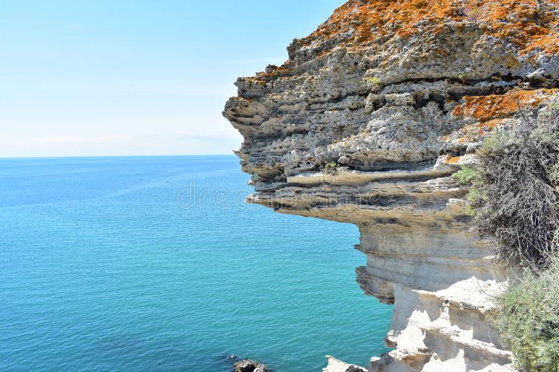 Cliffs at Black Sea with blue sky and calm water. In summer time stock images