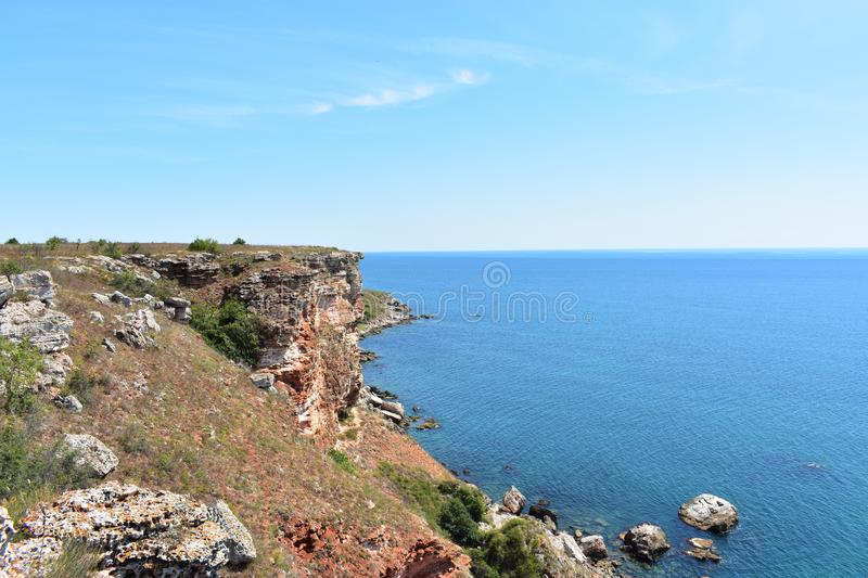 Cliffs at Black Sea with blue sky and calm water. In summer time stock photo