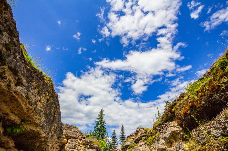 Cliffs, blue sky and mountain tops royalty free stock photo