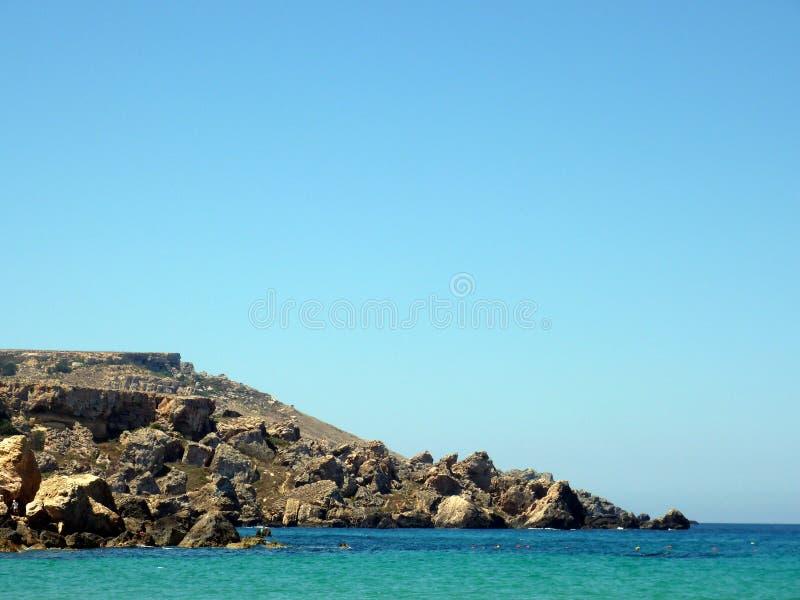 Cliffs in Comino island. Cliffs in the blue lagoon, Comino island, Malta stock image